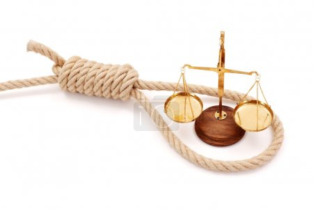 Photo for Miniature golden scale in thick halter. Conceptual view of justice system being strangulated - Royalty Free Image