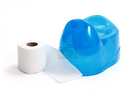 Photo for White toilet paper roll beside of blue potty on white background - Royalty Free Image