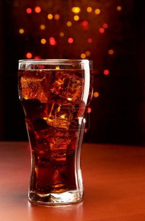 Photo for Cola with ice, bokeh background - Royalty Free Image