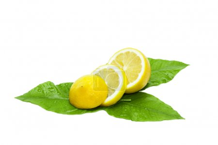 Photo for Sliced wet fresh lemon with leaves. Healthy food isolated on white. - Royalty Free Image