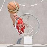Basketball player shooting...