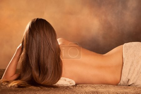Photo for Beautiful woman back lie in spa salon - Royalty Free Image