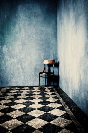 Photo for Grunge room with blue old walls tiled floor and wooden chair in corner - Royalty Free Image
