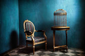 Louis table, armchair and old golden bird cage