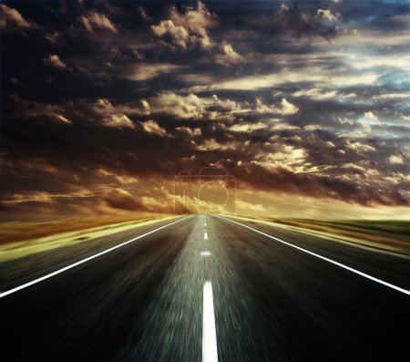 Photo for Blurry asphalt road and clouds - Royalty Free Image