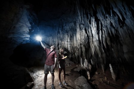 Cave. Young couple