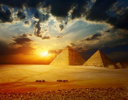 Grate pyramids in Giza valley in Egypt with group ...