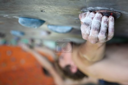 Photo for Young man climbing indoor wall - Royalty Free Image