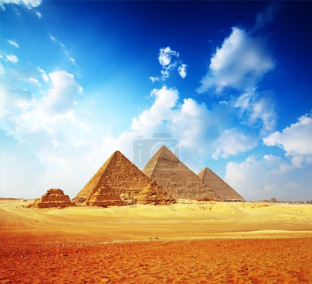 Giza valley with Great pyramids with blue cloudy s...
