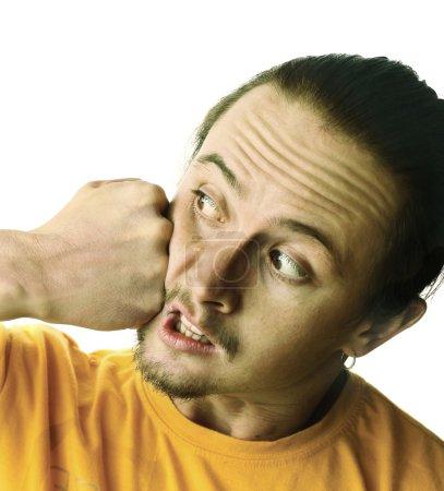 Photo pour L'homme se fait botter isolé sur blanc - image libre de droit
