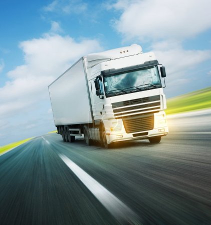 Photo for White truck on asphalt road under sky with clouds - Royalty Free Image