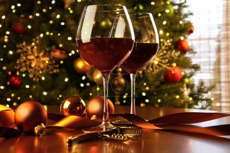 Red wine on table Christmas tree