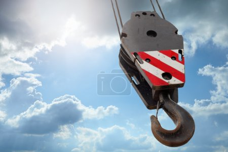 Crane hook on a blue sky