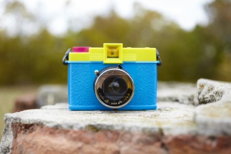 Photo for Plastic toy camera in closeup, selective focus on lens - Royalty Free Image