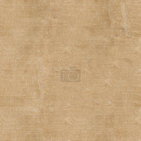 Foto de Viejo libro en una funda de tela sobre un fondo blanco. textura de la tela sin costura - Imagen libre de derechos