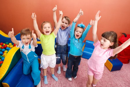 Photo for Group of shouting kids with hands up - Royalty Free Image