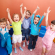 Group of shouting kids with hands up...
