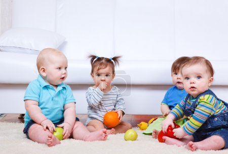 Photo for Group of fiur friendly babies - Royalty Free Image