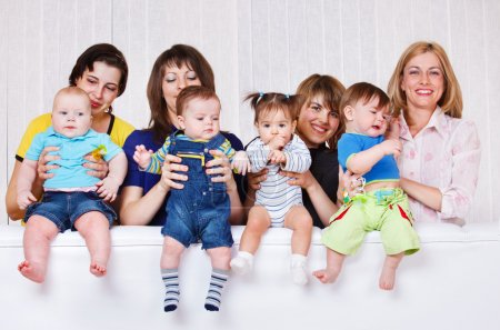 Photo for Happy mothers playing with their babies - Royalty Free Image