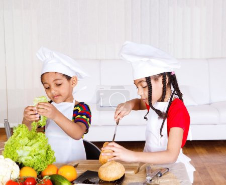 Photo for Lovely school aged siblings making sandwich - Royalty Free Image