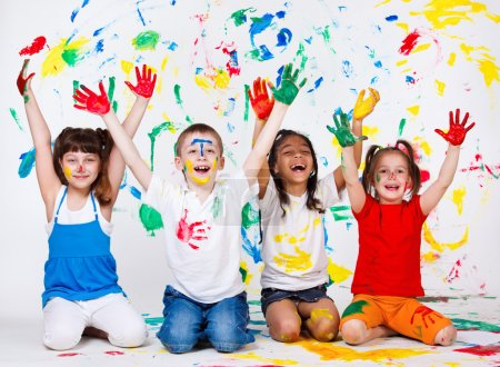 Photo for A group of cheerful kids with their palms and clothing painted - Royalty Free Image