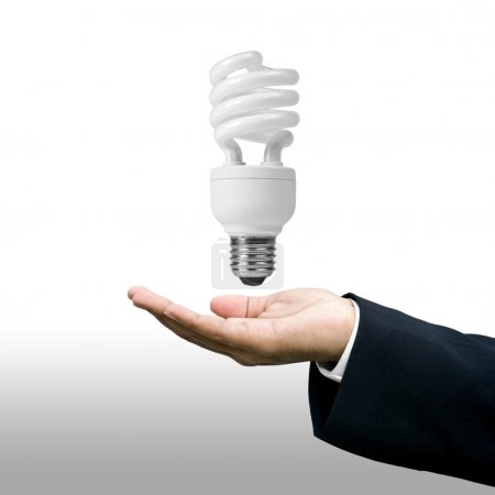 Photo for Grown up of Light bulb in businessman's hand - Royalty Free Image