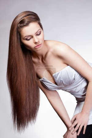 Woman with long hair looking down