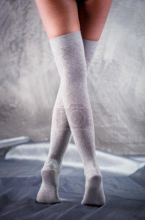 Beautiful woman legs in cotton stockings