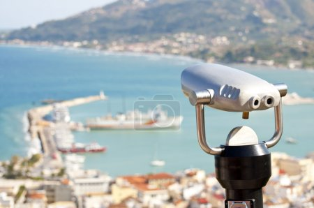 Binocular viewer looking out over small town