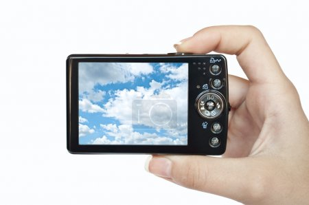 Photo camera in hand isolated on white background sky photograph