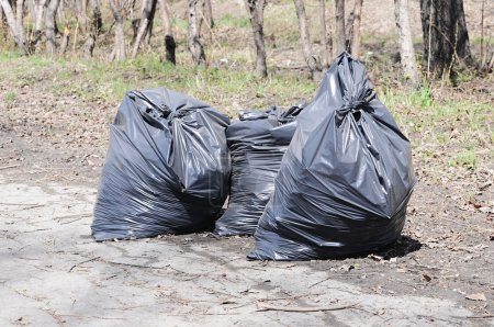 Pile of garbage on green grass in the nature environment problem