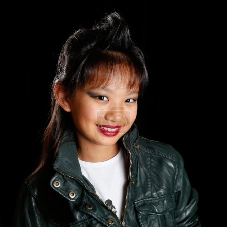 Asian girl with a fashionable hairstyle smiling