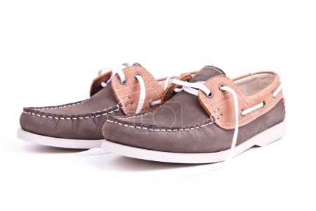 Elegance new moccasins on white background in stud...