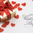 Art valentine's greeting card with gift box on whi...