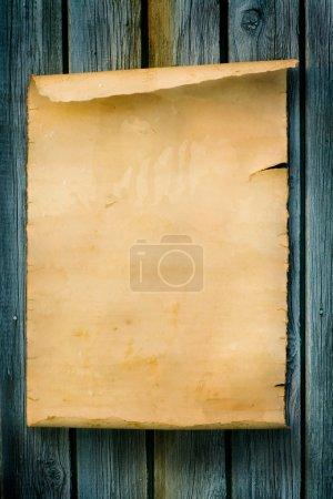 Foto de Madera y papel de pergamino antiguo estilo occidental signo - Imagen libre de derechos