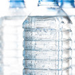Clear unlabelled plastic bottles of healthy pure c...