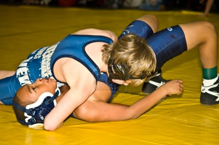 Photo for Two young boys wrestling at the Dixie Nationals Championship in Atlanta GA. - Royalty Free Image