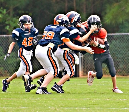 Youth League Football Tackling the Runner