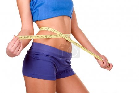 Photo for Woman measuring perfect shape of beautiful thigh. Healthy lifestyles - Royalty Free Image
