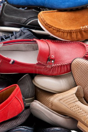 Background of various male shoes, closeup view...