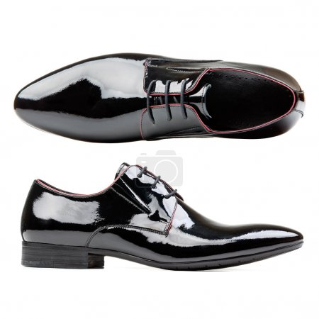 Black patent leather men shoes against white