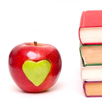 Apple with green heart and stack of books