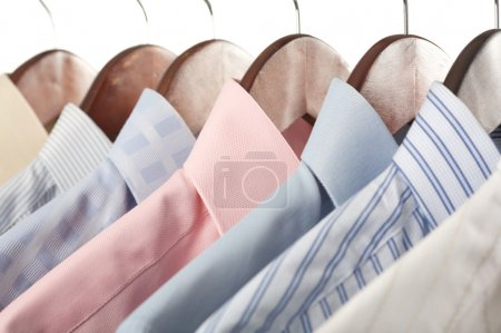Photo for Close-up rack shirts isolated on white background - Royalty Free Image
