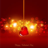 Festive background for Valentine's Day with heart hanging on ribbon