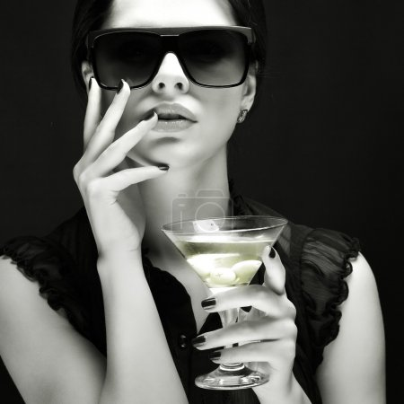 Photo for Beautiful young girl with glass of martini - Royalty Free Image