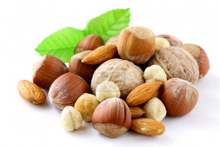 Photo for Mix nuts - walnuts, hazelnuts, almonds on a white background - Royalty Free Image