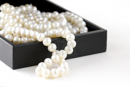 Photo for Macro pearls in black gift box - Royalty Free Image