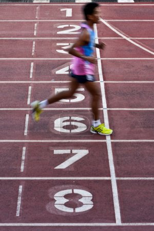Photo for Male athletes starting the 100m sprint, blurred motion - Royalty Free Image