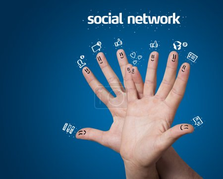 Photo for Happy group of finger smileys with social network sign and icons on blue background - Royalty Free Image
