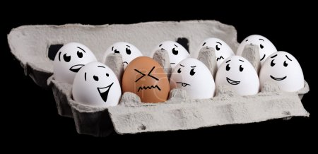Photo for The odd one, funny eggs with smiley faces - Royalty Free Image